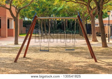 Two seats swings at children' playground in park
