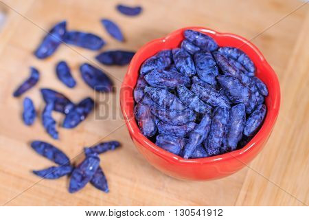 Fresh ripe honeysuckle berries in a bowl