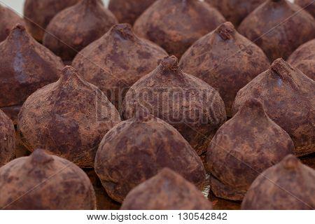 Chocolate truffles closeup horizontal selective focus background