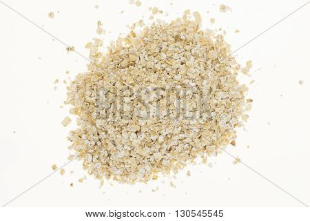Heap of oatmeal, isolated on white background
