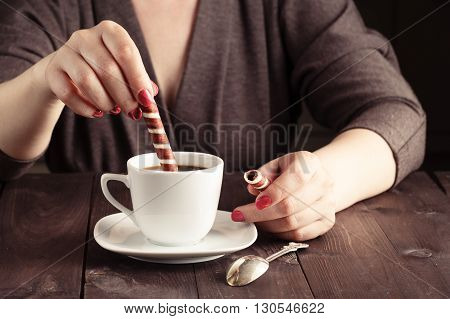 White Hot Coffee Cup In Woman Hand