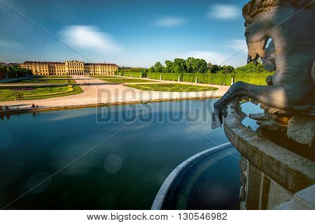 VIENNA, AUSTRIA - CIRCA APRIL 2016: Schonbrunn palace with fountain. This palace is one of the most important historical places in Austria. Long exposur technic with glossy water and blurred clouds