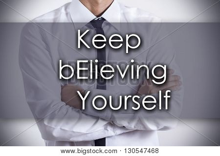 Keep Believing Yourself Key - Young Businessman With Text - Business Concept