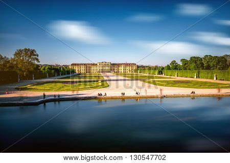 VIENNA, AUSTRIA - CIRCA APRIL 2016: Schonbrunn palace with fountain in Vienna. This palace is one of the most important historical places in Austria. Long exposure technic with blurred people