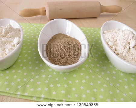 Flour and dry bakers yeast in small bowls