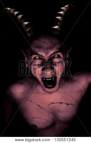 devil vampire coming out from darkness at Halloween