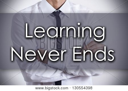 Learning Never Ends  - Young Businessman With Text - Business Concept