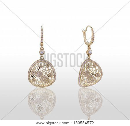Gold earrings with precious stones. Isolated on white background.