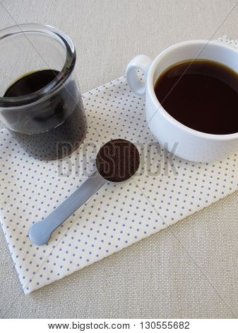 Cup of cold brewed coffee and coffee concentrate