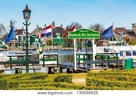 Zaanse schans, Netherlands - April 1, 2016: Panorama with boat pier in Zaanse Schans in Netherlands, Holland near Amsterdam