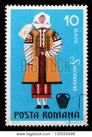 ZAGREB, CROATIA - JULY 19: A stamp printed in Romania shows image of a Suceava woman, from the regional costumes series, circa 1973, on July 19, 2012, Zagreb, Croatia