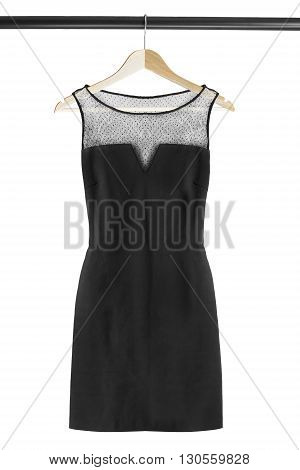 Black elegant dress on clothes rack isolated over white