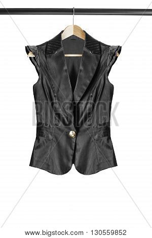 Black silk vest on clothes rack isolated over white