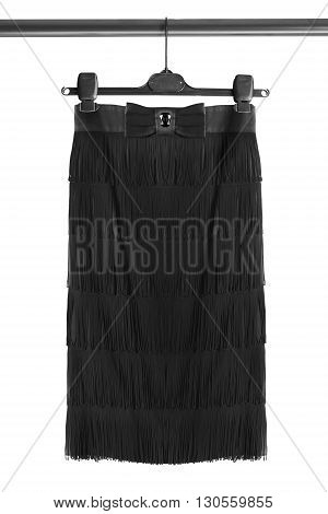 Beautiful black skirt on clothes rack isolated over white