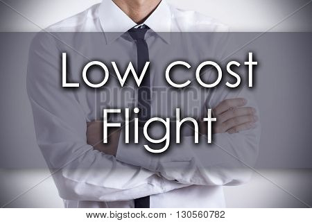 Low Cost Flight - Young Businessman With Text - Business Concept