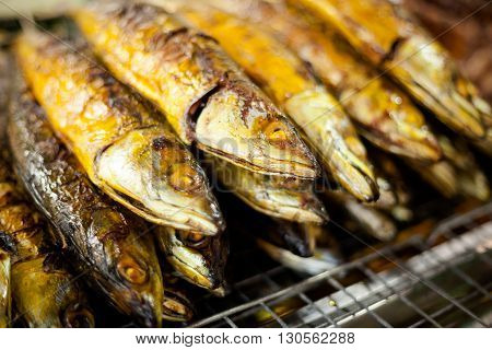 Fresh grilled whole meckerel fish. Traditional thai cuisine.