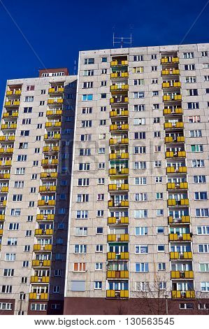 The facade of a residential high-rise building in Poznan