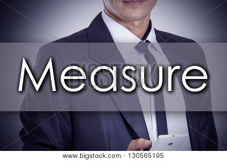 Measure - Young Businessman With Text - Business Concept