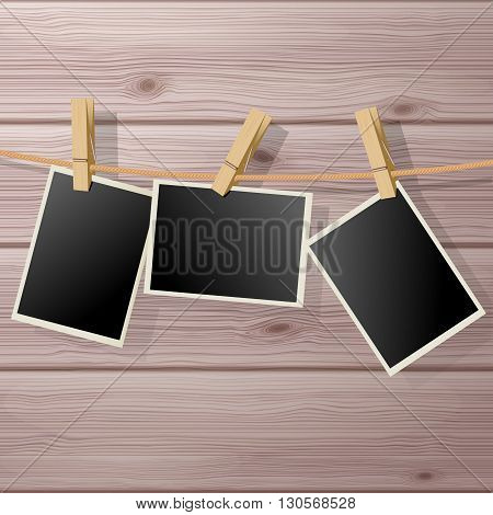 Photo Frame Fixed Hanging with Clothespins on Wooden Background