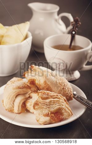 Homemade pastry with orange and Mugs of  Green Tea on old wooden table. .Toned photo
