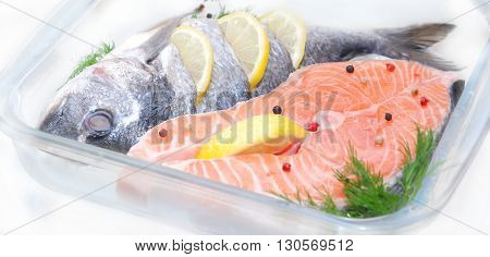 salmon fish with lemon and spice defrosting before cooking