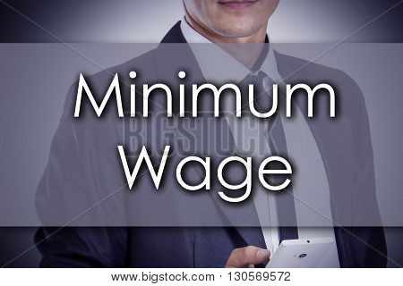 Minimum Wage - Young Businessman With Text - Business Concept