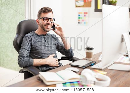 Happy Designer Talking On A Smartphone