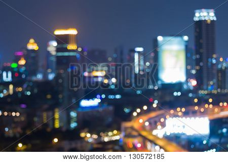 Abstract blurred lights, office building at twilight, aerial view