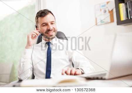Businessman Doing Some Sales Over The Phone