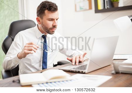 Young Businessman With Reading Glasses