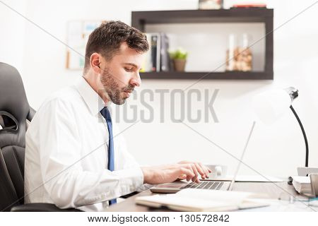 Busy Businessman Typing On A Laptop