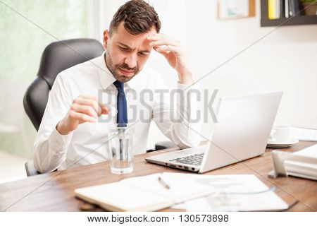 Businessman Feeling Unwell At Work