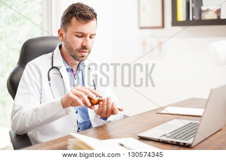 Doctor Taking Some Pills For Himself