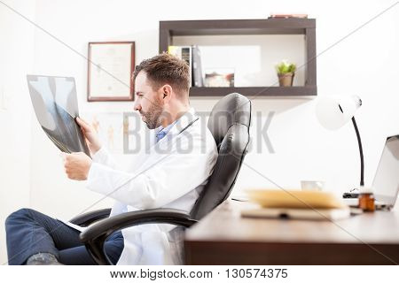 Doctor Reviewing Some X-rays In His Office