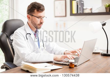 Doctor Wearing Reading Glasses At His Office