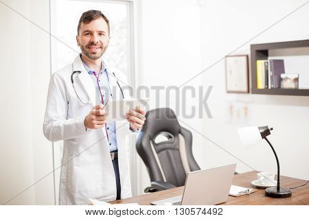 Physician Using A Tablet In His Office