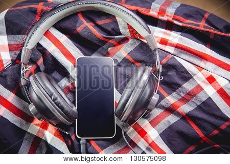 Phone And Headphones On A Shirt, Listening To Music
