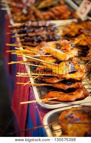 Fresh made chicken wing satay skewer. Traditional thai cuisine on market.