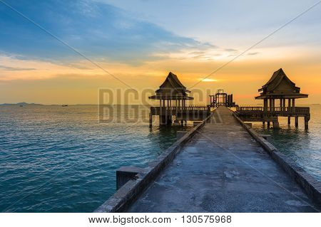 Abandon Temple in the sea with beautiful sky during sunset