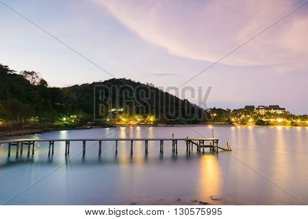 Beautiful skylines over coastline wooden jetty night view