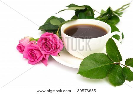 white Cup of coffee and pink roses