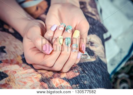 Manicure On The Tablecloth Of Flowers