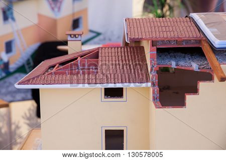 Model of detached house on white background