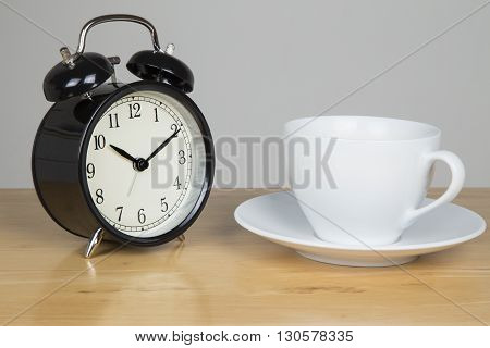 Bell alarm clock and cup of tea