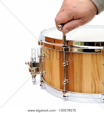 Master tuning new wooden snare drum isolated closeup