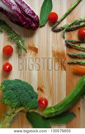 flat lay green vegetables on wood background frame