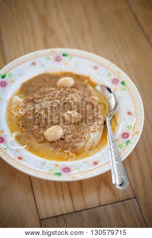 Fresh glass noodles with shrimp paste served with fishballs. Traditional thai cuisine.