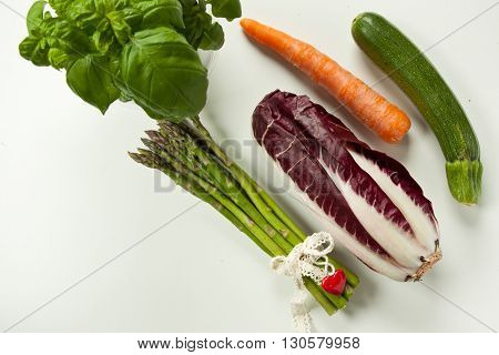 flat lay green vegetables on white background