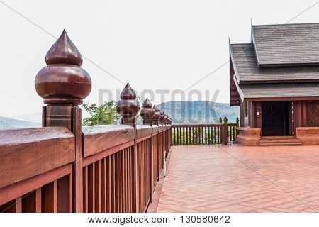 Wooden balconies around the temple on the hill.