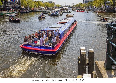 Amsterdam, Netherlands - May 5: This is celebration of Independence Day the residents of the Netherlands on the river Amstel May 5, 2013 in Amsterdam, Netherlands.
